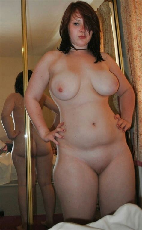 Plump Amateur Shows Off Her Round Tits By The Mirror