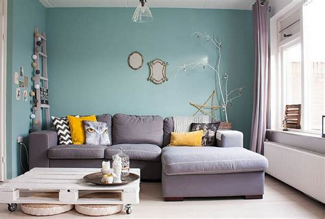 lovely living room interior desig with blue wall paint