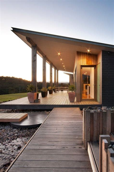 single pitch roof exterior farmhouse  shading wooden interior sliding doors roof