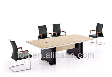modern conference room table and 6 black leather chairs