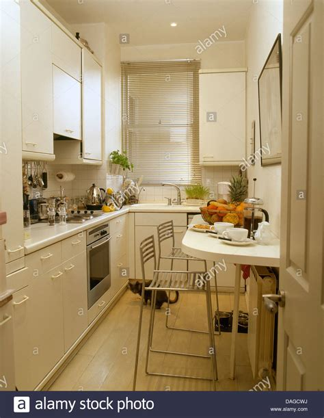 galley kitchens with breakfast bar modern white galley kitchen with chrome stools at 6786