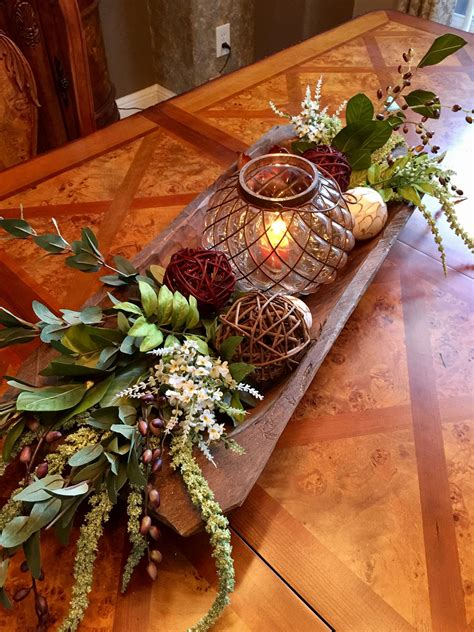 This tabletop decoration not only looks fantastic on its own but can also be used to hold various items around the house. Rustic Dough Bowl Centerpiece #farmhouseinspiration | Farmhouse table centerpieces, Coffee table ...
