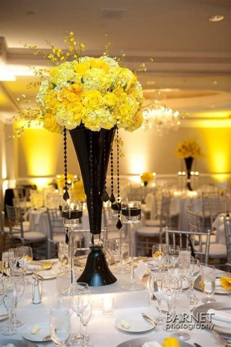 black  yellow centerpiece  yellow pinterest