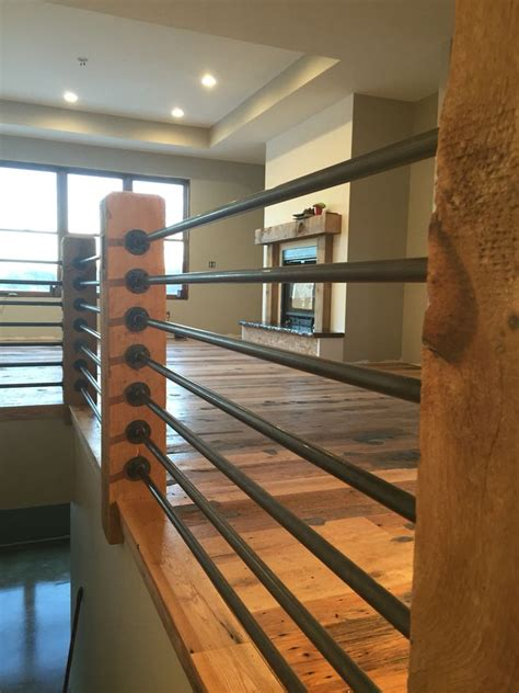 black gas pipe rails reclaimed rustic oak barn wood