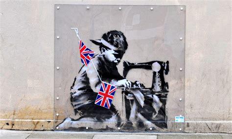 banksy slave labour mural row  erupts   sale