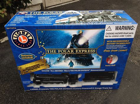 electric train under christmas tree the polar express lionel g gauge scale battery train