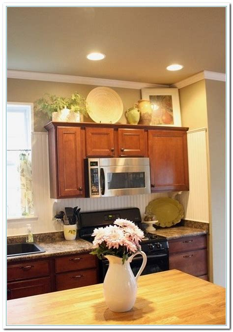 decorating above kitchen cabinets ideas 5 charming ideas for above kitchen cabinet decor home