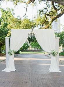 ceremony location created with pipe drape suspended With location for wedding ceremony