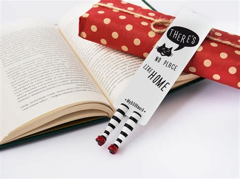 quirky bookmarks   tiny legs  literary characters sticking   pages