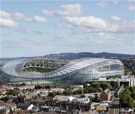 gold canopy stadia architectural design populous stadium