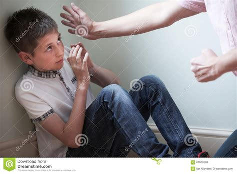 father  physically abusive  son stock photo