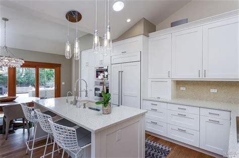 contemporary kitchen  pental sparkling white quartz robert abbey bling large chandelier