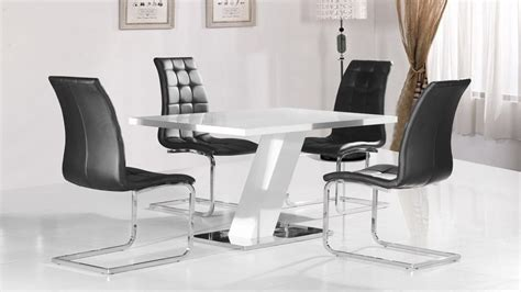 white high gloss dining table and 4 black chairs with