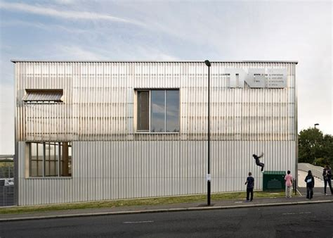 corrugated concrete and polycarbonate panels been used to create a textured and translucent