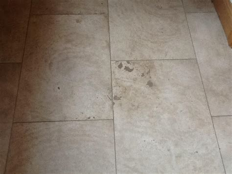 renovating a badly stained and marked travertine