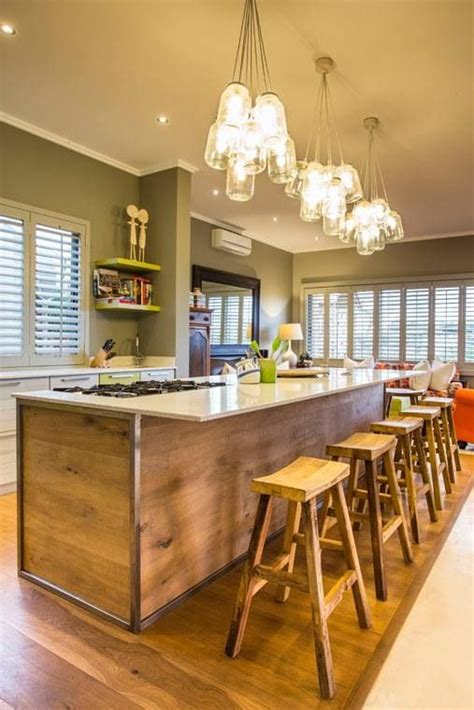 A contrasting kitchen island allows you to introduce new color and texture to the room in an understated yet impactful way. Kitchen, wood island, lighting and wall Colour | Kitchen ...