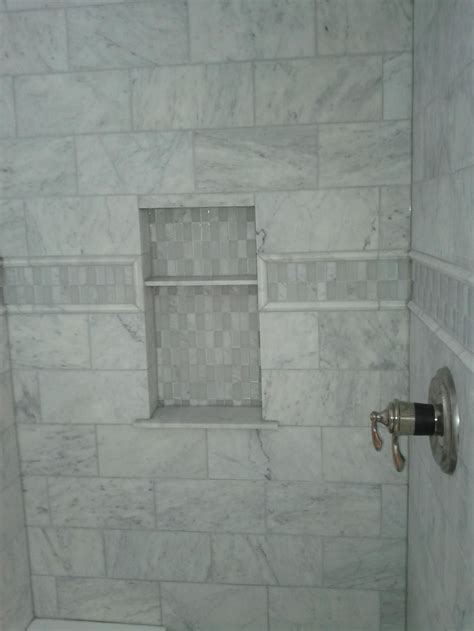 picture shows  marble tile shower   accent