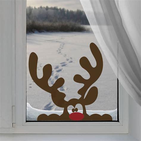 Weihnachtsdeko Fenster Bilder by Peeping Reindeer Window Sticker By Nutmeg