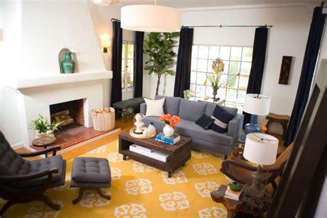 white spanish modern living room  yellow rug hgtv
