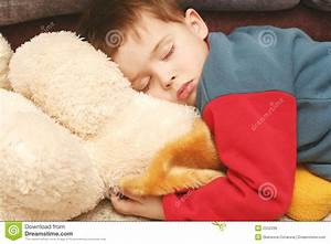 The Child Sleeping In Clothes Stock Photo