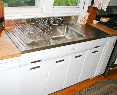 vintage kitchen sink with drainboard joe replaces a vintage porcelain drainboard kitchen sink