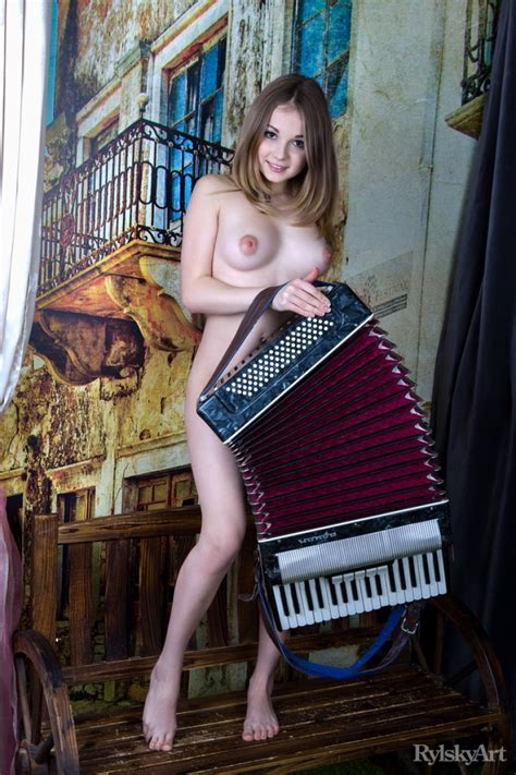 Naked Teen Playing The Accordion