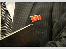 Illegal Sale of 'Double Portrait' Lapel Pins Flourishes in
