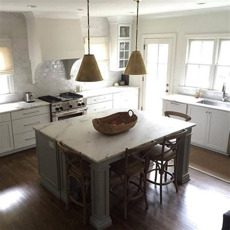 gray kitchen island  gold pendants transitional