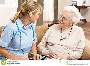 Senior Woman In Discussion With Health Visitor Stock ...