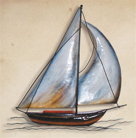 Decorating your outdoor walls will make time spent in your al fresco living space even more inviting. Metal Sailboat Wall Sculpture, Sailing Decor, & Sail Boat Wall Hangings from Everything Nautical
