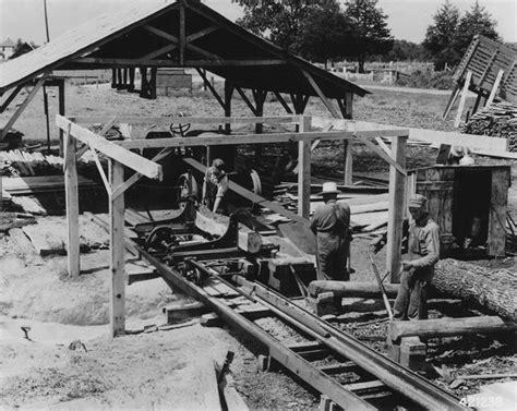 small portable sawmill sawing lumber  ties
