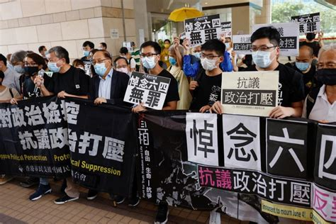 Two dozen Hong Kong activists in court over banned ...