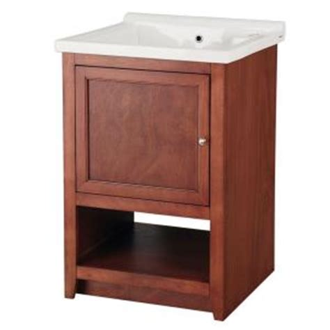 foremost westmount laundry cabinet in light walnut and