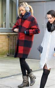 laura whitmore heads  wearing red  black checked