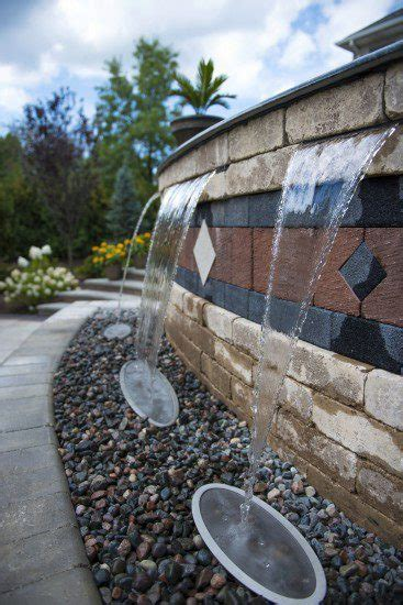 unilock products add stunning water features to your landscape with these