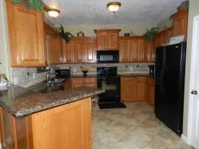 Granite for Oak Cabinets with Black Appliances Kitchen