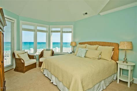 cottage master bedroom with high ceiling carpet crown