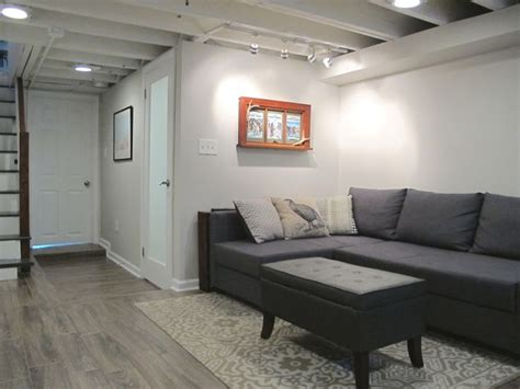 cozy chic basement reno  exposed painted joists wood