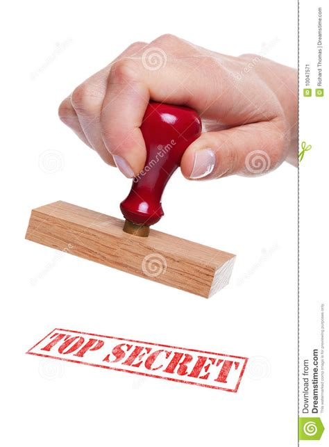 Hand Holding A Rubber Stamp With The Words Top Sec Stock