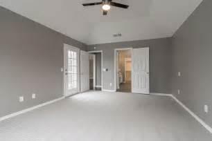 gray walls white trim bedroom master bedroom ensuite patio door gray walls vaulted ceiling white trim gray carpet