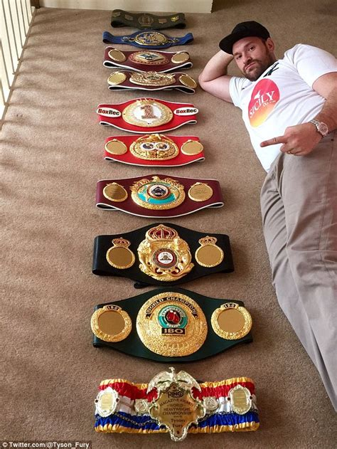 Tyson Fury poses with all his belts - on the day he is set ...