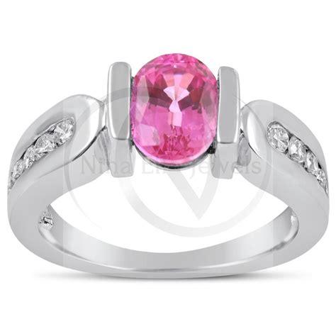 oval cut tension set pink sapphire channel set diamonds