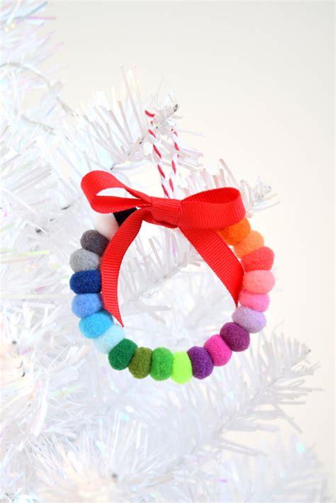pom pom christmas ornaments the pom pom ornament craft that never ends northstory