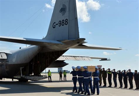 Malaysia airlines flight 17 (mh17) was a scheduled passenger flight from amsterdam to kuala lumpur that was shot down on 17 july 2014 while flying over eastern ukraine. First MH17 bodies arrive in grieving Netherlands