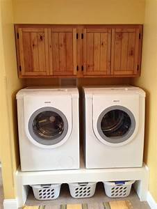 Love my cabinets and storage for clothes baskets under the for Under cabinet washer and dryer