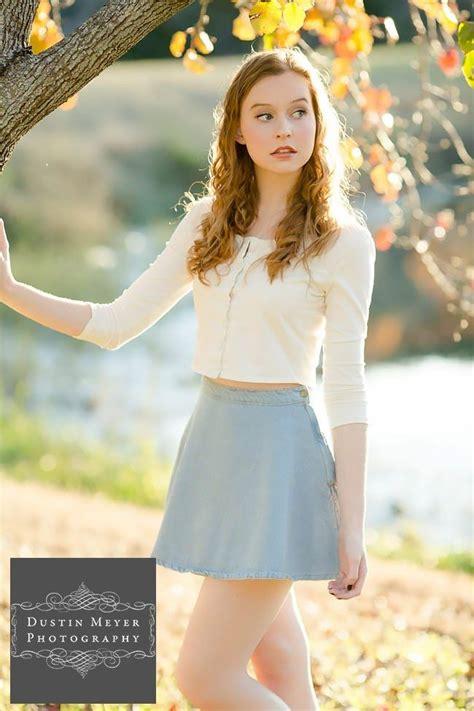 gorgeous female senior portraits blue skirt white button