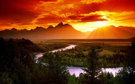 red sky sunlight sunset curve river pine forest rocky