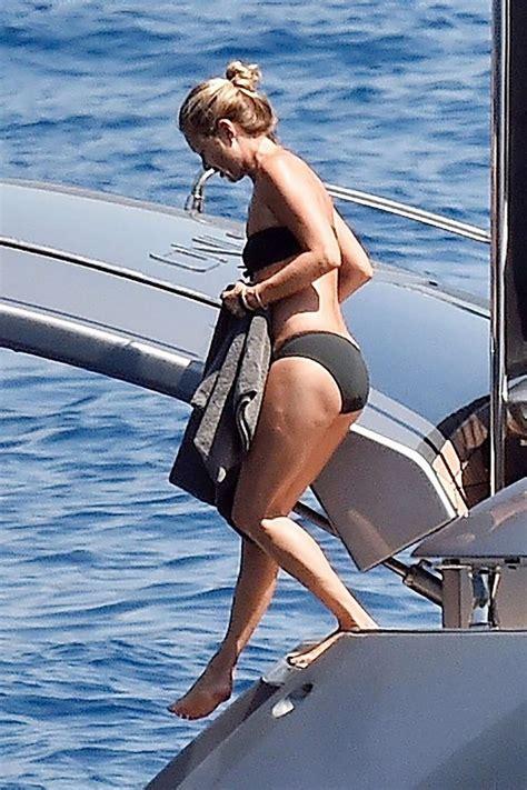 kate moss wears a black bikini as she takes a dive into ...