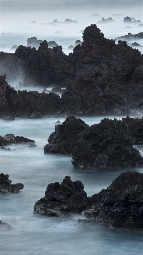 long exposure  surf pouring  lava rocks  easter