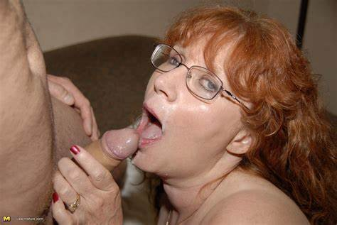 Granny In Glasses Having The Male